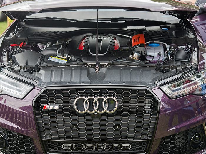 Under the hood of a purple Audi